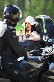 woman eye-flirting motorrider
