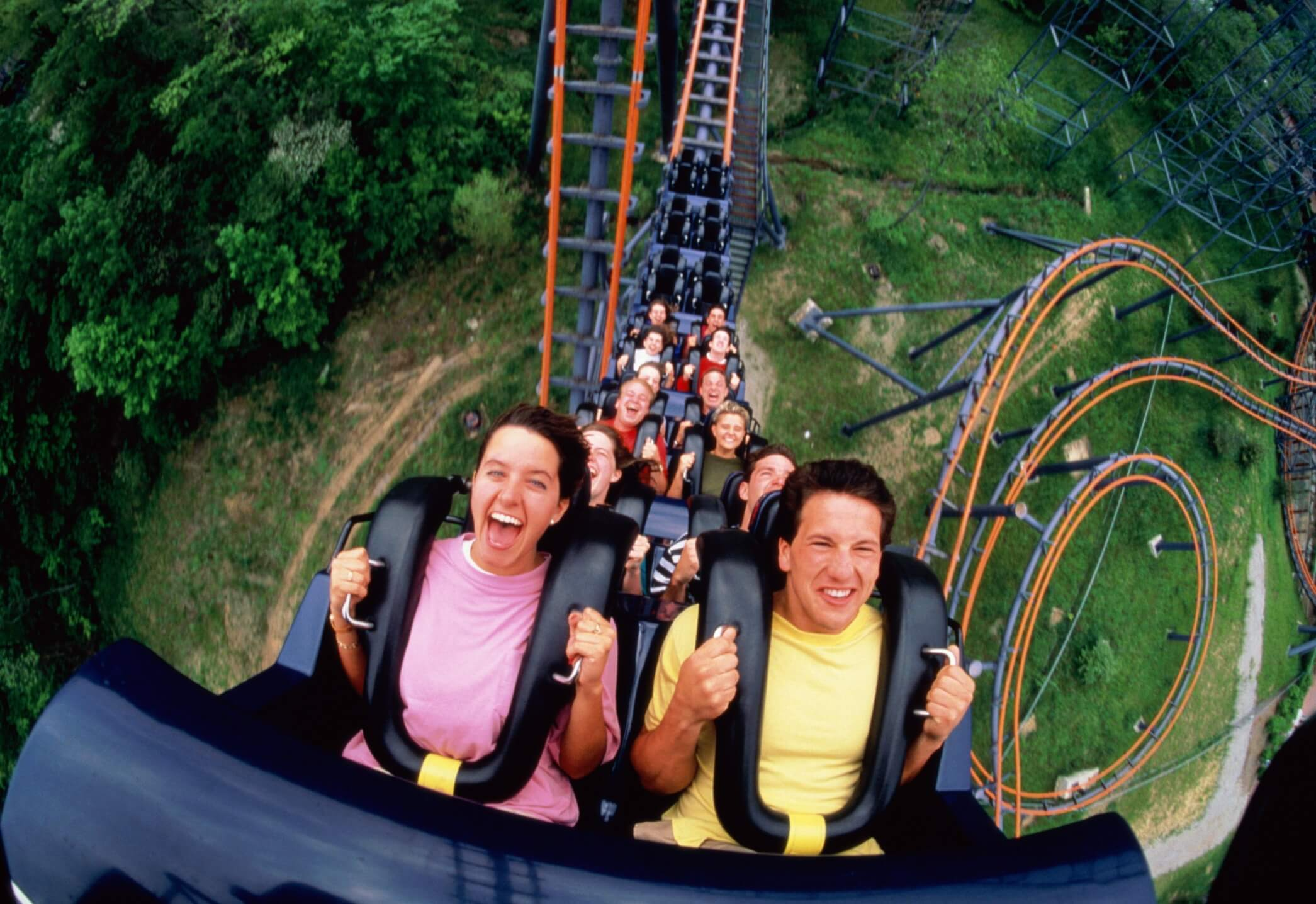 People on roller coaster, elevated view, (wide angle)